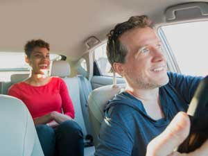 Happy woman and Uber driver.